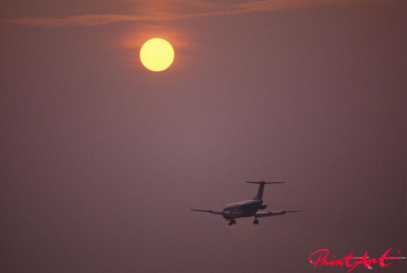 Anflug im Sonnenuntergang Flugzeuge